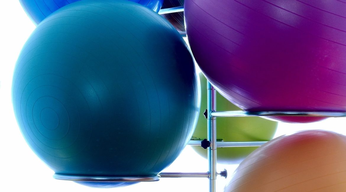 Can Sitting On An Exercise Ball Save You From Back Pain At Work?